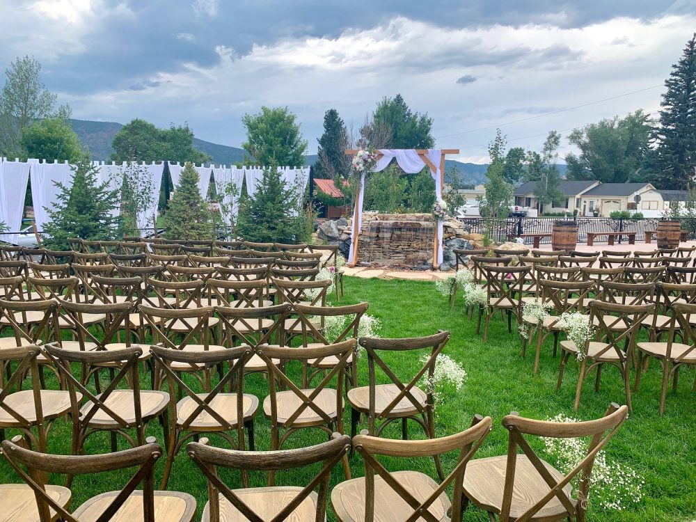 Outdoor Ceremony Set Up at Hearth House with Draping Hearth House